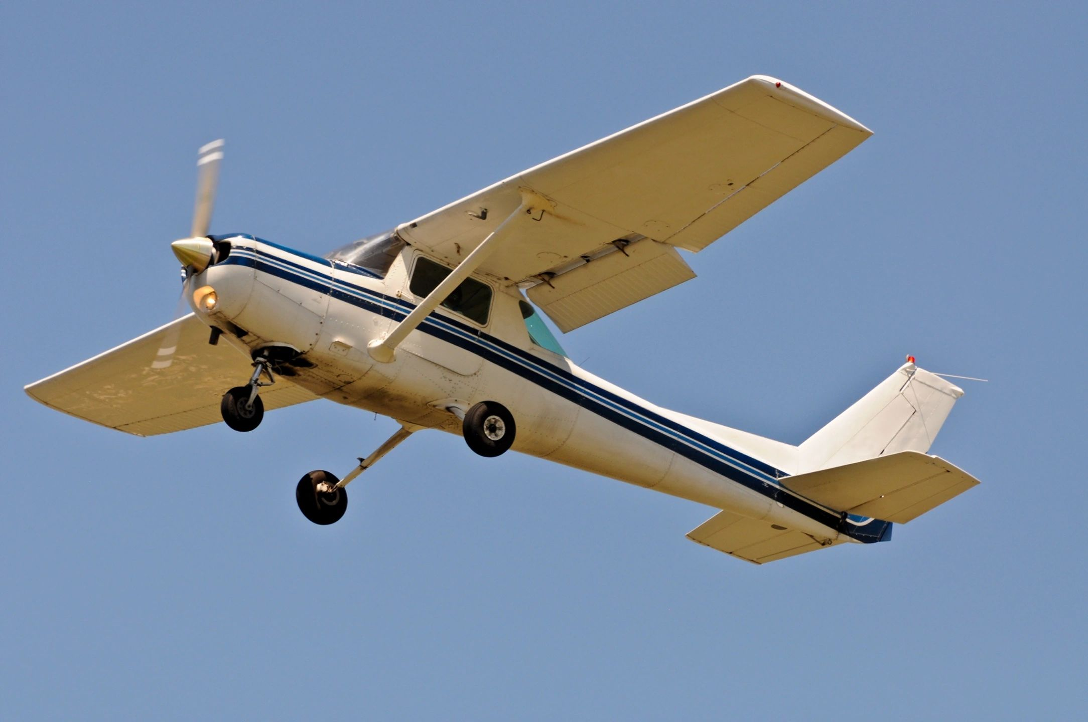 White and Blue Striped Cessna 150 Aircraft